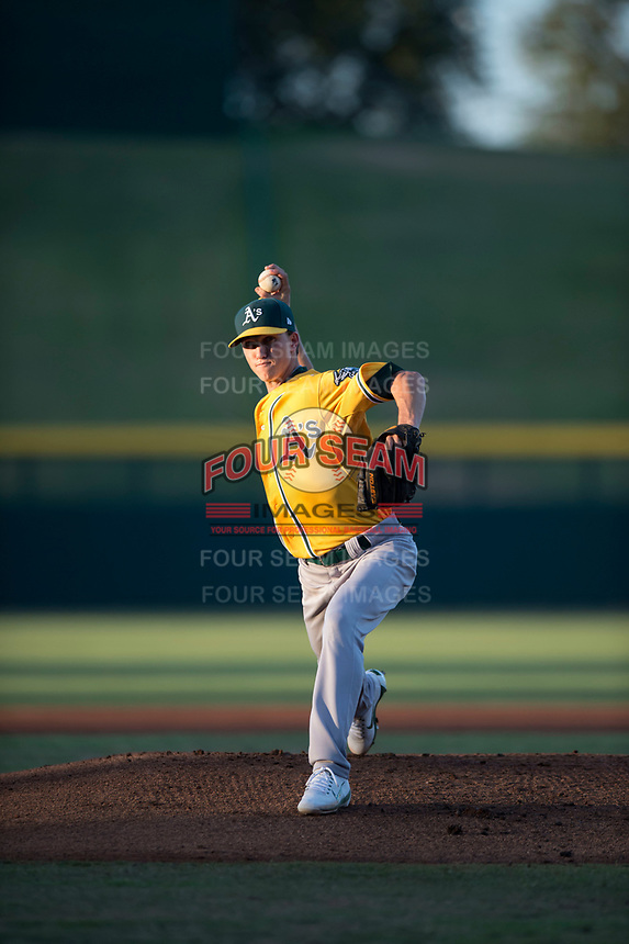 AZL Athletics starting pitcher Calvin Coker (45) delivers a pitch during an Arizona League game against the AZL Cubs 1 at Sloan Park on June 28, 2018 in Mesa, Arizona. The AZL Athletics defeated the AZL Cubs 1 5-4. (Zachary Lucy/Four Seam Images)