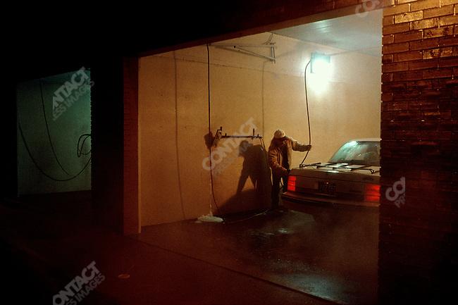 Washing Oldsmobile Cutlass Sierra, Lansing, Michigan, USA, February 2001