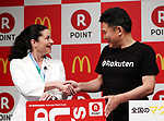 May 26, 2017, Tokyo, Japan - Japan's online commerce giant Rakuten president Hiroshi Mikitani shakes hands with McDonald's Japan president Sarah Casanova as they announce that Rakuten's point service can be used at McDonald's restaurants in Japan from June 1 at a press conference in Tokyo on Friday, May 26, 2017.   (Photo by Yoshio Tsunoda/AFLO) LwX -ytd-