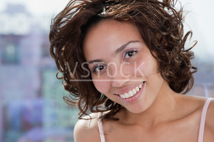 USA, New York State, New York City, portrait of young woman smiling