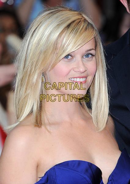 "REESE WITHERSPOON.""Water For Elephants"" UK film premiere,.Vue Westfield, Upper Level, Westfield Shopping Centre, White City, London, England, UK..May 3rd 2011.headshot portrait blue strapless bustier off the shoulder smiling .CAP/BEL.©Tom Belcher/Capital Pictures."