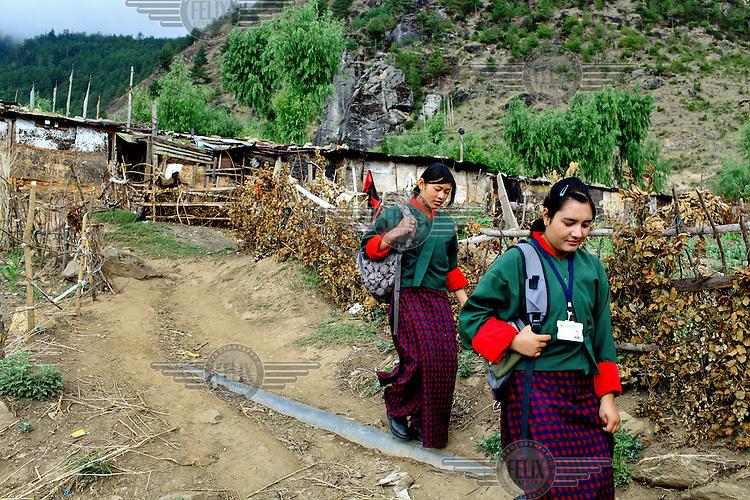 Girls make their way to school through the kala bazaar slum.