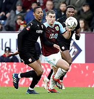 Burnley's Sam Vokes vies for possession with Barnsley's Ethan Pinnock<br /> <br /> Photographer Rich Linley/CameraSport<br /> <br /> Emirates FA Cup Third Round - Burnley v Barnsley - Saturday 5th January 2019 - Turf Moor - Burnley<br />  <br /> World Copyright &copy; 2019 CameraSport. All rights reserved. 43 Linden Ave. Countesthorpe. Leicester. England. LE8 5PG - Tel: +44 (0) 116 277 4147 - admin@camerasport.com - www.camerasport.com
