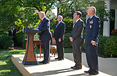 "United States President Donald J. Trump, left, makes remarks establishing the US Space Command in the Rose Garden of the White House in Washington, DC on Thursday, August 29, 2019.  The Space Command will be the lead military agency for the planning and execution of space operations and will be a step towards establishing a Space Force as a new military service. With the President, from left to right: US Vice President Mike Pence,US Secretary of Defense Dr. Mark T. Esper, and General John W. ""Jay"" Raymond, Commander, Air Force Space Command.<br /> Credit: Ron Sachs / Pool via CNP"