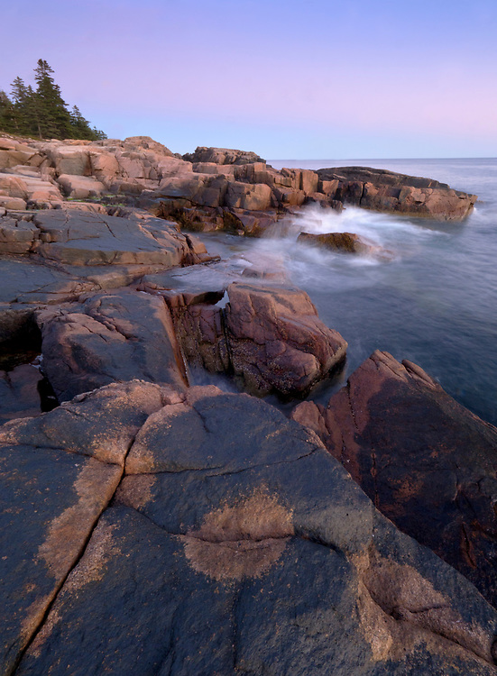 The Earth Shadow sets at dusk over patterned granite rock formations at Otter Point along Ocean Drive/Park Loop Road on Mount Desert Island, Acadia National Park, ME