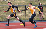 THOMASTON,  CT-040919JS09-  Thomaston's Benjamin Brickett, left takes the baton teammate Patrick Hyres, right, as they compete in the 4x100 meter relay during their Berkshire League meet with Housatonic Tuesday at Nystrom's Sports Complex in Thomaston.<br /> Jim Shannon Republican American