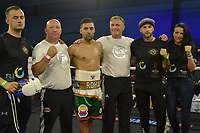 Rohan Date (gold/white/green shorts) draws with Wes Smith during a Boxing Show at Bracknell Leisure Centre on 8th July 2018