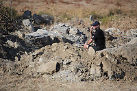 Pictured: A forensics officer conducts a preliminary search at the new site in Kos, Greece. Friday 07 October 2016<br />Re: Police teams led by South Yorkshire Police, searching for missing toddler Ben Needham on the Greek island of Kos have moved to a new area in the field they are searching.<br />Ben, from Sheffield, was 21 months old when he disappeared on 24 July 1991 during a family holiday.<br />Digging has begun at a new site after a fresh line of inquiry suggested he could have been crushed by a digger.