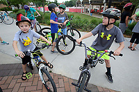 NWA Democrat-Gazette/DAVID GOTTSCHALK  Asher Copeland (left), a kindergarten student at George Elementary School, and Mason Miller (right) a third grade student wait Wednesday, May 10, 2017,  with students from the school on Shiloh Square in Springdale. Students from the school participated in the second annual Springdale City-Wide Walk and Bike to School Day. The students rode from the square to the school on the Razorback Regional Greenway. Mayor Doug Sprouse read a proclamation before the start of the ride.