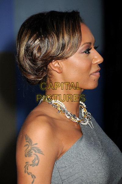 "MELANIE BROWN (MEL B).The Cable Show 2010 ""An Evening with NBC Universal"" held at Universal Studios Hollywood, Universal City, California, USA..May 12th, 2010.headshot portrait chains hair up necklace silver gold daggers pearls scary spice grey gray one shoulder profile tattoo.CAP/ADM/BP.©Byron Purvis/AdMedia/Capital Pictures."