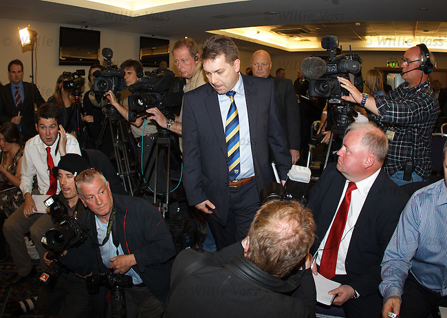 David Longmuir chief executive of the Scottish Football League makes his way past the massed members of the media to announce that Rangers have been accepted as an associate member of the SFL and have been invited into Division 3 for the start of the season 2012-13
