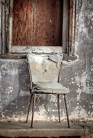 A chair sitting in front of an old gas station in the Ghost Town of Glenrio Texas on Route 66.