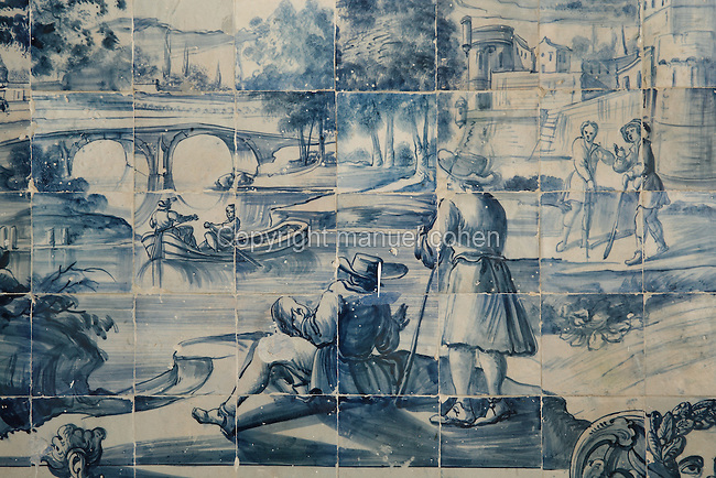 Men arriving in a boat, from scenes of the history of the monastery and the Siege of Lisbon in 1147, traditional blue and white azulejos tile scene, 18th century, in the Monastery of Sao Vicente de Fora, an Augustinian order monastery and church built in the 17th century in Mannerist style, Lisbon, Portugal. The monastery also contains the royal pantheon of the Braganza monarchs of Portugal. Picture by Manuel Cohen
