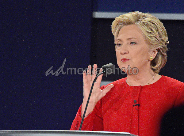 Former United States Secretary of State Hillary Clinton, the Democratic Party nominee for President of the US makes a point as she appears in the first of three presidential general election debates with businessman Donald J. Trump, the Republican Party nominee for President of the US at Hofstra University in Hempstead, New York on Monday, September 26, 2016. Photo Credit: Ron Sachs/CNP/AdMedia