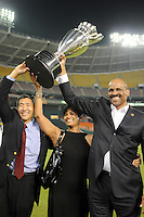DC United owners William Chang, left, and Victor Macfarlane, right, with his wife lifts the US. Open Cup Trophy, DC United defeated The Charleston Battery 2-1 to win the US. Open Cup, Wednesday September 3, 2008 at RFK Stadium.