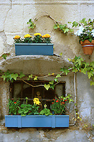 Spain, Segovia. Flowers and window boxes on stone wall in the city center. Segovia Castilla Y Leon Spain.