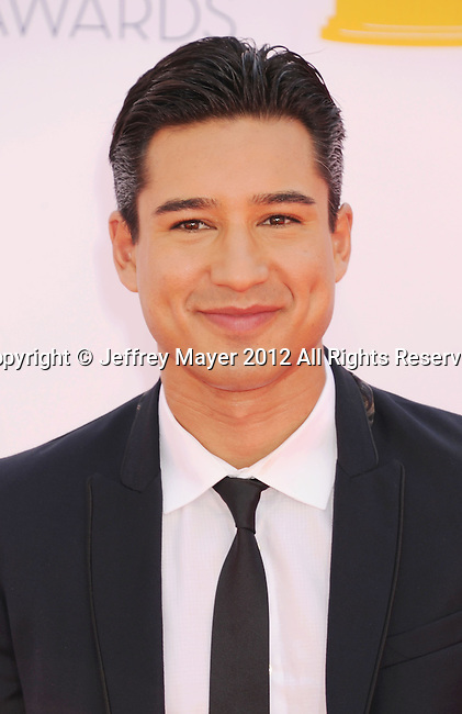 LOS ANGELES, CA - SEPTEMBER 23: Mario Lopez arrives at the 64th Primetime Emmy Awards at Nokia Theatre L.A. Live on September 23, 2012 in Los Angeles, California.