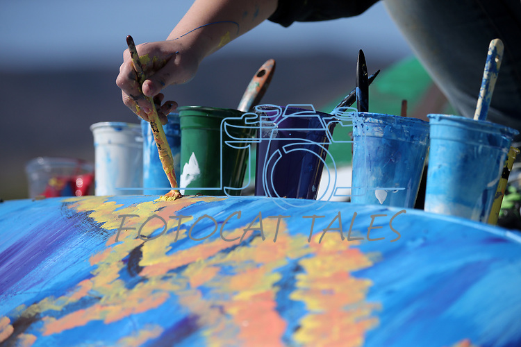 Doral Red Rock Academy student Adela Del Rivero, 15, paints a Cadillac at the driving range at the Silver Oak Golf Course, in Carson City, Nev., on Sunday, April 8, 2018. The Las Vegas art students' work was a Carson City history theme. <br /> Photo by Cathleen Allison/Nevada Momentum