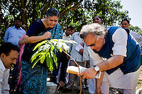 Dr. Vandana Shiva (third from left) looks on as the Minister of Environment, Sr. Jairam Ramesh (right) plants a lychee tree to inaugurate Navdanya's newly built community center, after his speech at the Regional Conference for Climate Change in Himalaya in Dehradun, Uttarakhand, India, on 6th September 2009...Dr. Vandana Shiva, the founder of Navdanya Foundation and Bijavidyapeeth, is a physicist turned environmentalist who campaigns against genetically modified food and teaches farmers to rely on indigenous farming methods.. .Photo by Suzanne Lee / For The National