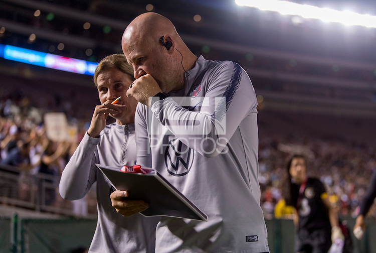 PASADENA, CA - AUGUST 4: Jill Ellis and Graeme Abel talk during a game between Ireland and USWNT at Rose Bowl on August 3, 2019 in Pasadena, California.
