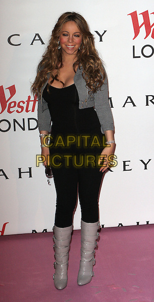 MARIAH CAREY .turns on the Christmas Lights at Westfield Shopping Centre, London, England. .November 19th 2009.full length black top trousers jeans denim tucked in knee high boots buckles grey gray wavy hair cropped knitted jacket bracelets .CAP/FIN.©Steve Finn/Capital Pictures.