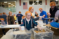 NWA Democrat-Gazette/CHARLIE KAIJO Laci Schulte, 9, of Fayetteville helps fill MannaPack meals, Sunday, March 4, 2018 at The Jones Center in Springdale.<br /><br />Tacos 4 Life and Feed My Starving Children hosted their first NWA MobilePack of the year. Nearly 1,000 volunteers worked together throughout the three days to pack MannaPack meals that Tacos 4 Life's guests have raised for the past several months.