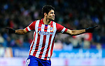 Diego Costa celebrates after scoring during the Spanish league football match Atletico de Madrid vs RCD Espanyol at the Vicente Calderon stadium in Madrid on March 15, 2014. <br />