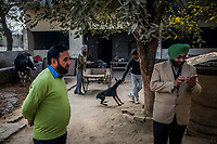 FARIDKOT, PUNJAB, INDIA - JANUARY 05, 2016: People gather at the property of Kushaldeep Singh Dhillon also known as KIKI, prior to a  greyhound race meet on January 5, 2016 in Faridkot, India. <br /> Daniel Berehulak for The New York Times