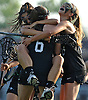 Farmingdale No. 6 Tara Wahl gets congratulated by No. 7 Jillian Alonso, left, and No. 28 Caroline Bleck after scoring a goal in the first half of a Nassau County varsity girls' lacrosse semifinal against Massapequa at Adelphi University on Tuesday, May 19, 2015. Farmingdale won by a score of 11-7.<br /> <br /> James Escher