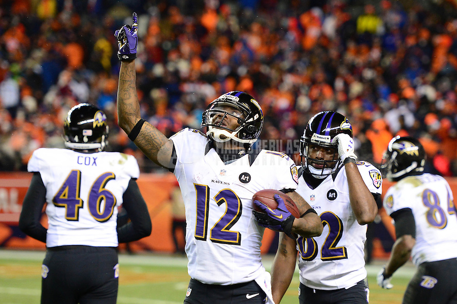 Jan 12, 2013; Denver, CO, USA; Baltimore Ravens wide receiver Jacoby Jones (12) celebrates after scoring a touchdown in the fourth quarter against the Denver Broncos during the AFC divisional round playoff game at Sports Authority Field.  The Ravens defeated the Broncos 38-35 in double overtime. Mandatory Credit: Mark J. Rebilas-