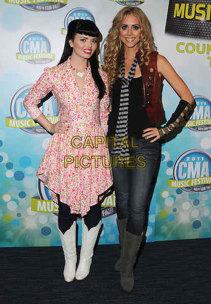 Susie Brown, Danelle Leverett of The JaneDear girls.2011 CMA Music Festival Nightly Concert Press Conference held at LP Field, Nashville, Tennessee, USA..June 12th, 2011.full length white pink boots jeans denim scarf stripe red  floral print dress hand on hip.CAP/ADM/GS.©George Shepherd/AdMedia/Capital Pictures.