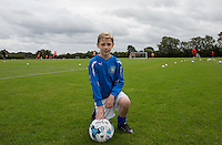 Taylor Hunt poses as the team train behind him as Ballboy Taylor Hunt  at Wycombe Wanderers Training Ground, High Wycombe, England on 25 August 2015. Photo by Andy Rowland.
