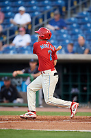 Clearwater Threshers left fielder Mickey Moniak (2) follows through on a swing during a game against the Jupiter Hammerheads on April 9, 2018 at Spectrum Field in Clearwater, Florida.  Jupiter defeated Clearwater 9-4.  (Mike Janes/Four Seam Images)