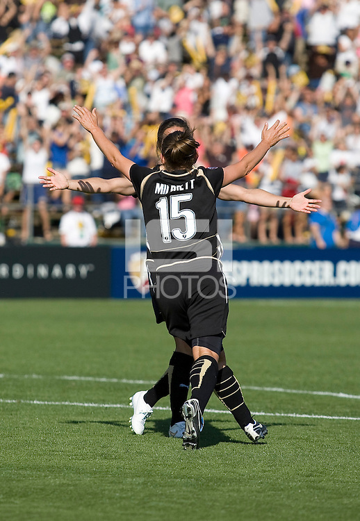 Tiffany Milbrett (15) celebrates with Brandi Chastain after scoring her goal to win the game. FC Gold Pride defeated the Boston Breakers 2-1 at Buck Shaw Stadium in Santa Clara, California on April 5th, 2009. Photo by Kelley Cox /isiphotos.com