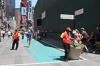 NEW YORK, NY - JUNE 21: Tour bus ticket sellers on the first day of NYPD (New York Police Department) enforcement of the new pedestrian zones in Times Square where costumed characters and those selling bus or show tickets are required to solicit only in the designated green zone in New York, New York on June 21, 2016.  Photo Credit: Rainmaker Photo/MediaPunch
