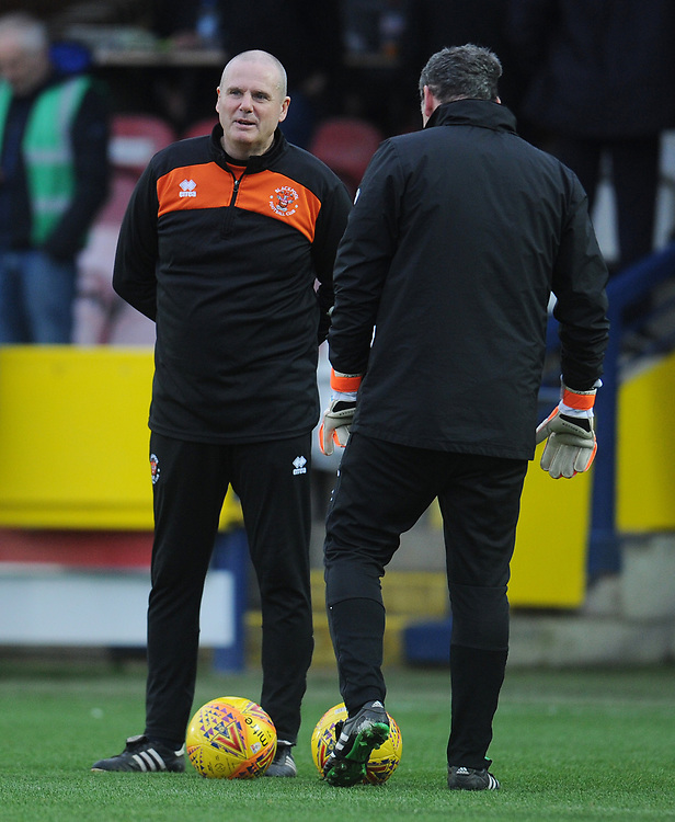 Blackpool Physio Phil Horner chats with Goalkeeper Coach Dave Timmins during the pre-match warm-up <br /> <br /> Photographer Kevin Barnes/CameraSport<br /> <br /> The EFL Sky Bet League One - AFC Wimbledon v Blackpool - Saturday 29th December 2018 - Kingsmeadow Stadium - London<br /> <br /> World Copyright © 2018 CameraSport. All rights reserved. 43 Linden Ave. Countesthorpe. Leicester. England. LE8 5PG - Tel: +44 (0) 116 277 4147 - admin@camerasport.com - www.camerasport.com