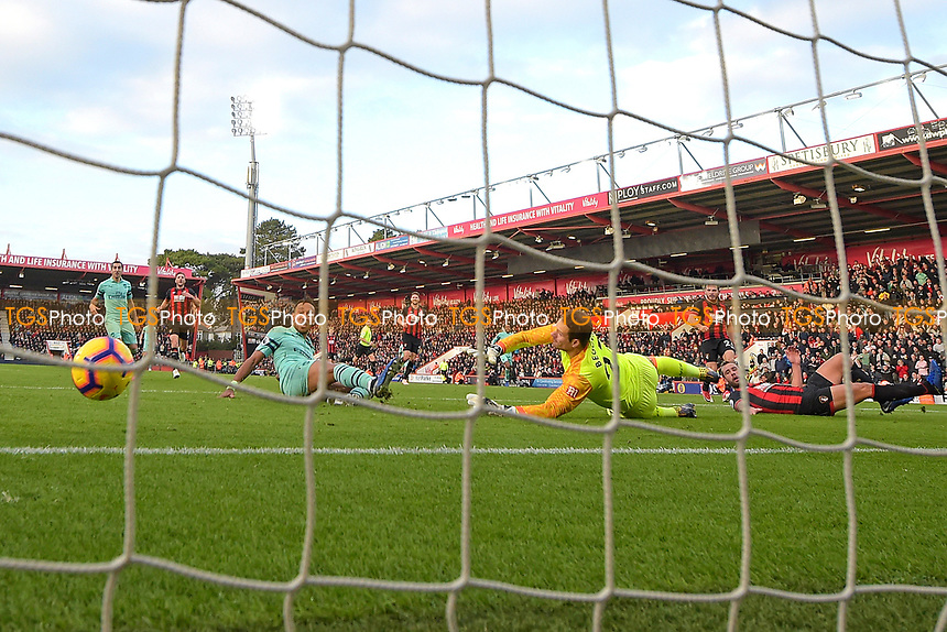 Pierre-Emerick Aubameyang of Arsenal left scores the second and winning goal past AFC Bournemouth keeper Asmir Begovic during AFC Bournemouth vs Arsenal, Premier League Football at the Vitality Stadium on 25th November 2018