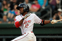 Center fielder Manuel Margot (2) of the Greenville Drive bats in a game against the Asheville Tourists on Monday, April 21, 2014, at Fluor Field at the West End in Greenville, South Carolina. Margot is the No. 13 prospect of the Boston Red Sox, according to Baseball America. Greenville won, 8-3. (Tom Priddy/Four Seam Images)