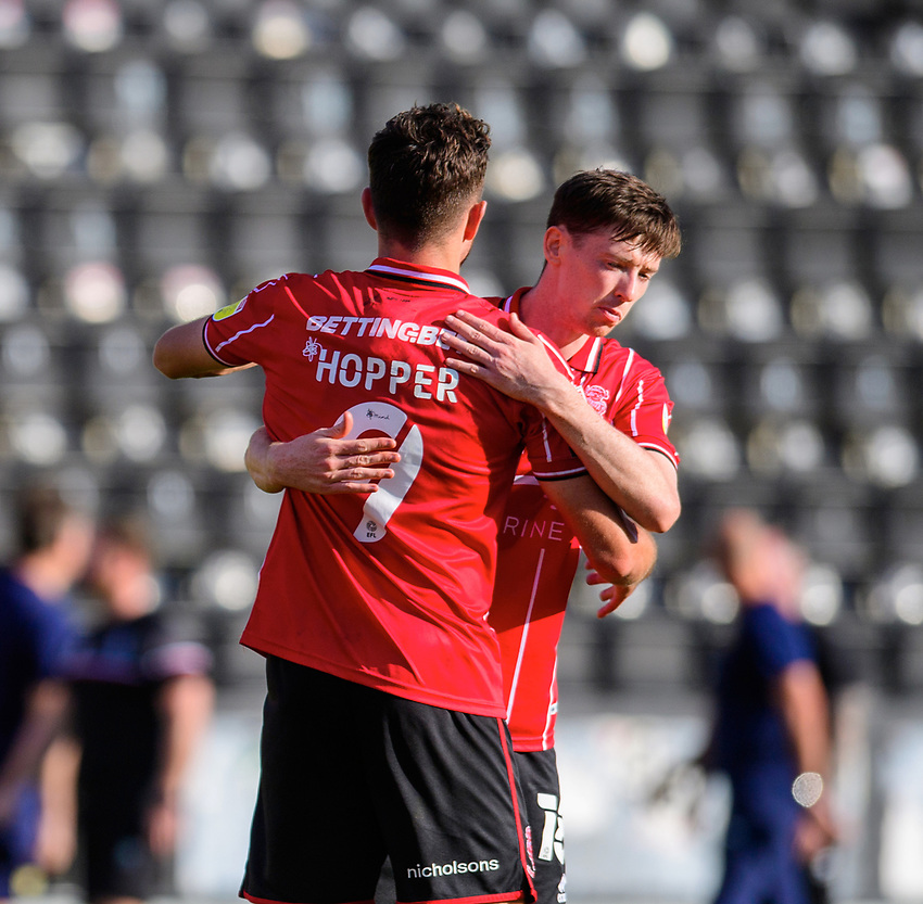 Lincoln City's Tom Hopper, left, with team-mate Conor McGrandles at the end of the game<br /> <br /> Photographer Chris Vaughan/CameraSport<br /> <br /> The EFL Sky Bet League One - Saturday 12th September 2020 - Lincoln City v Oxford United - LNER Stadium - Lincoln<br /> <br /> World Copyright © 2020 CameraSport. All rights reserved. 43 Linden Ave. Countesthorpe. Leicester. England. LE8 5PG - Tel: +44 (0) 116 277 4147 - admin@camerasport.com - www.camerasport.com - Lincoln City v Oxford United