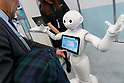 A man tests a humanoid robot Pepper during SoftBank Robot World 2017 on November 21, 2017, Tokyo, Japan. SoftBank Robotics organized SoftBank Robot World 2017 to introduce AI (Artificial Intelligence) and IoT (the Internet of Things) companies developing the latest technology for robots, including applications its humanoid robot Pepper in various business fields. The robot expo runs until November 22. (Photo by Rodrigo Reyes Marin/AFLO)