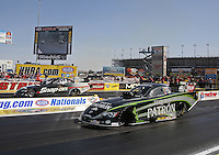 Apr. 7, 2013; Las Vegas, NV, USA: NHRA funny car driver Alexis DeJoria (near lane) races alongside Cruz Pedregon during the Summitracing.com Nationals at the Strip at Las Vegas Motor Speedway. Mandatory Credit: Mark J. Rebilas-