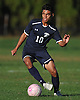 Alex Martinez #10 of Plainview JFK moves the ball downfield during the first half of a Nassau County Conference AA-3 boys soccer game against host Westbury High School on Friday, Oct. 14, 2016. Plainview JFK won by a score of 1-0.
