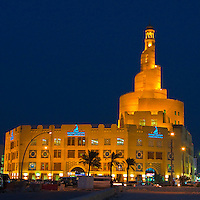Doha, Qatar.  Kassem Darwish Fakhroo Centre, based on the Great Mosque of al-Mutawwakil, in Samarra, Iraq.  Headquarters of the Qatar Islamic Cultural Center.  Night Scene.