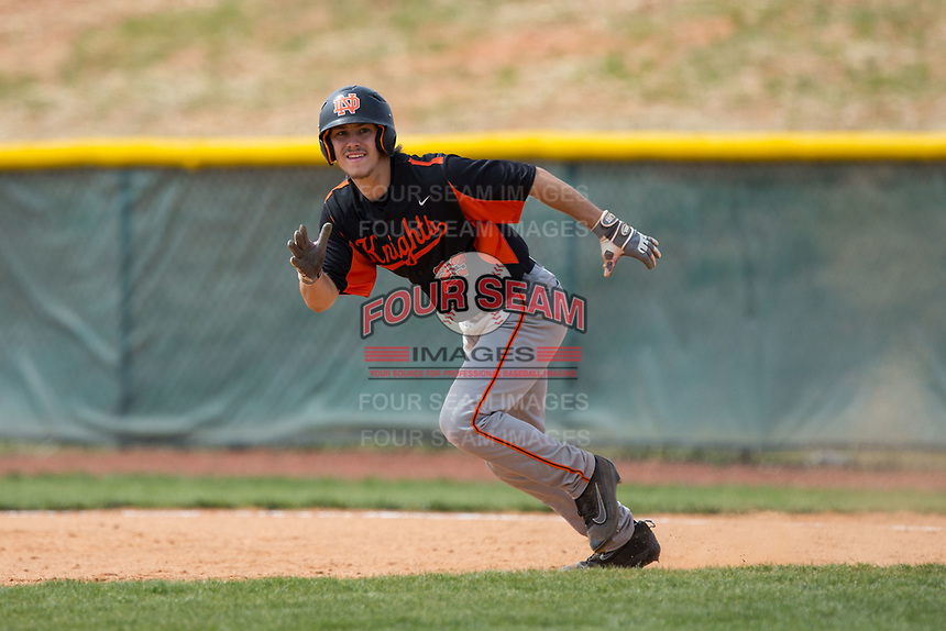 Austin Beck (23) of the North Davidson Knights takes off for second base during the game against the Alexander Central Cougars at Bob Gryder Stadium on March 25, 2017 in Taylorsville, North Carolina.  The Knights defeated the Cougars 3-0.  (Brian Westerholt/Four Seam Images)