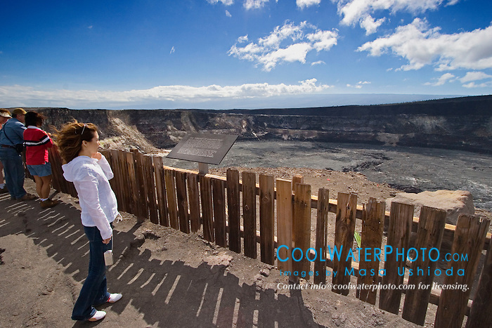 Woman visitor observing Halema`uma`u Crater, Kilauea Caldera, Hawaii Volcanoes National Park, Big Island, Hawaii