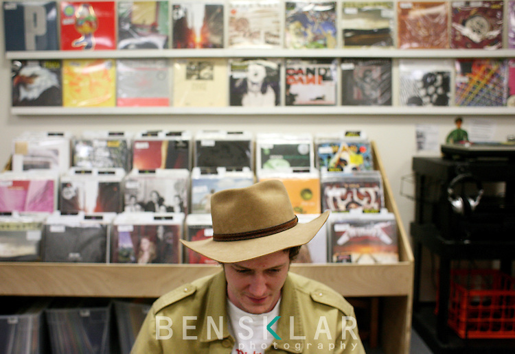 Jeff Cooper browses records at Backspin Records in Austin, Texas on February 14, 2009. Austin hosts the South by Southwest Music Festival and is home to notable record stores that continue to stock, buy and sell vinyl records enriching its homegrown music scene.  (Photo by Ben Sklar for the New York Times)