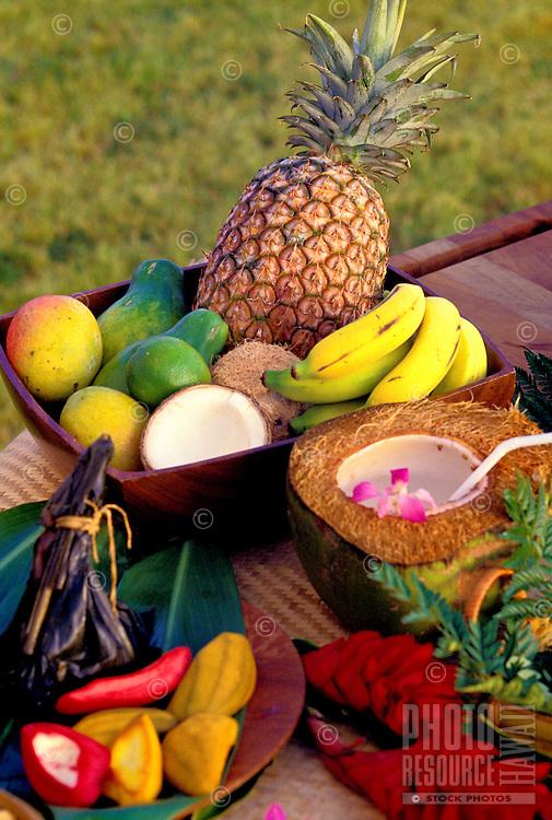 Arrangement of tropical fruits including pineapple, banana, mango, coconut and papaya