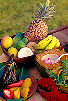 Arrangement of tropical fruits including pineapple, banana, mango, coconut and papaya