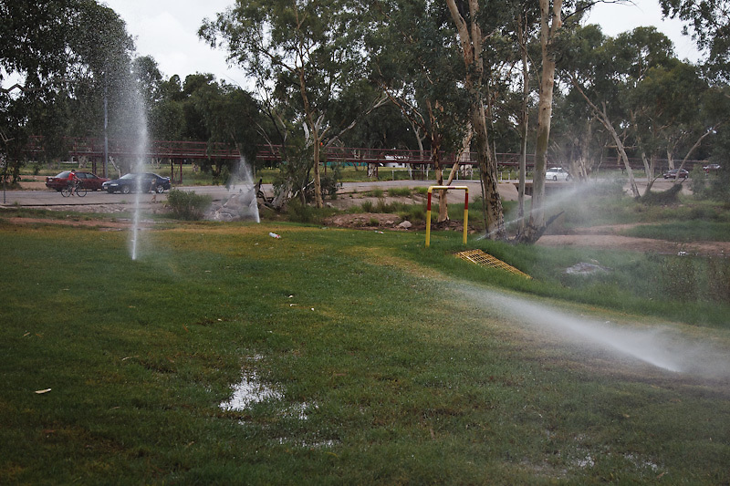 despite the flood warnings   the council irrigation system churns on regardless. It must be green.