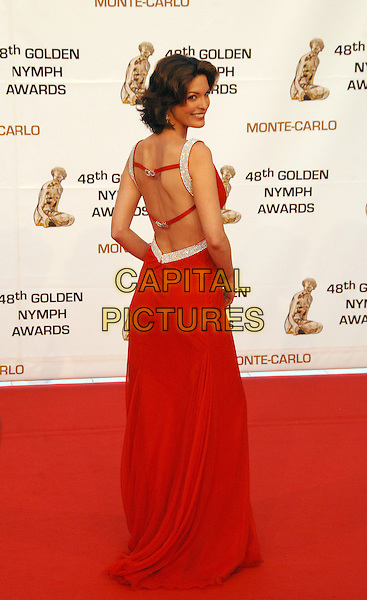 ALANA DE LA GARZA.Attending the Golden Nymph awards ceremony during the 2008 Monte Carlo Television Festival held at Grimaldi Forum, Monte Carlo, Principality of Monaco, June 12, 2008..full length red dress long silver back rear behind over shoulder.CAP/TTL .©TTL/Capital Pictures